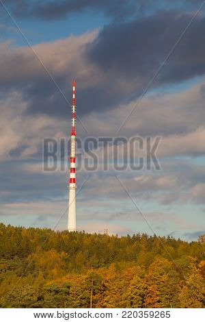 TV transmitter in the autumn forest, czech Republic