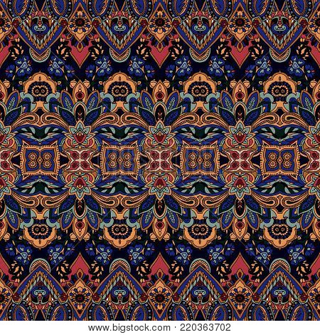 Seamless abstract geometric paisley pattern. Traditional oriental ethnic ornament, on navy blue background. Textile design.