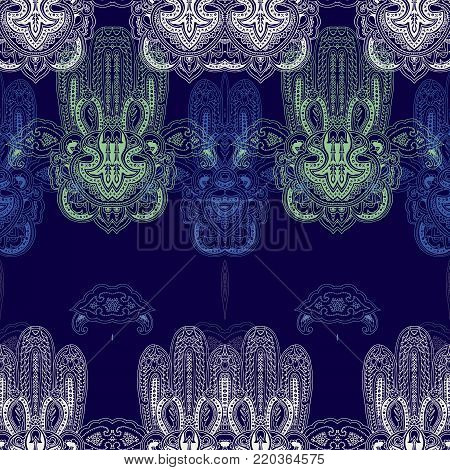 Seamless abstract geometric paisley pattern with stylized lace hamsa symbols. Traditional oriental ethnic ornament, pastel hues on indigo blue background. Yoga ornamental texture. Textile design.