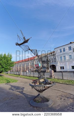 Rybinsk, Russia - June 3 2016. Sculptural composition Trawl standing on the bank of the Volga