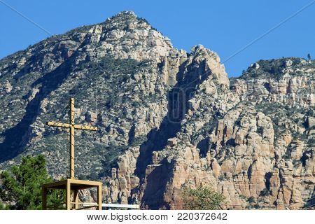 A Christian cross against a mountain background in Sedona