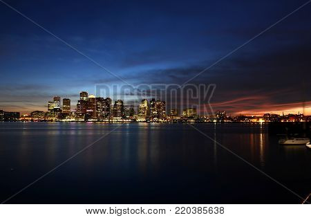 Boston City Skyscrapers, Custom House and Boston Waterfront at night from East Boston, Boston, Massachusetts, USA.