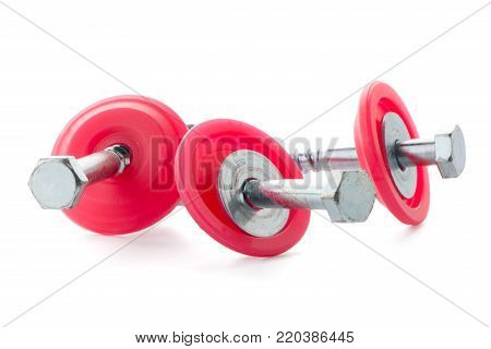 Hexagonal threaded steel bolts or screws on white background.