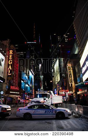 Manhattan, New York, December 31, 2017: NYPD car at Theater District on West 42nd street next to Times Square at night