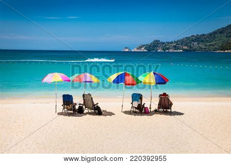 Tourists at Patong beach in Phuket, Thailand. Phuket is a popular destination famous for its beaches.