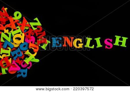 Colorful english word on black background , English language learning concept.