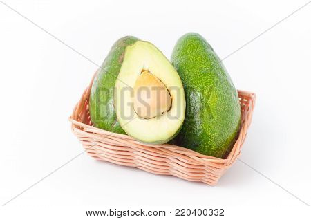 Avocado fruit in a basket on white background, Healthy fruit