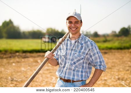Portrait of a smiling farmer in his field