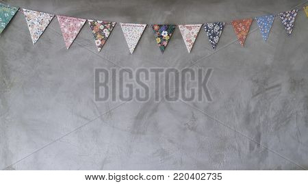 Triangle papers hanging on the grey wall decoration in house, stock photo