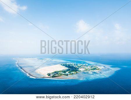 Aerial view of the tropical island of Himmafushi. Kaafu atoll, Maldives