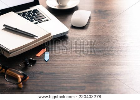 Office Desk Table With Computer, Phone, Eyeglass, Silver Pen, Blue And Yellow Paper Clip And Black C