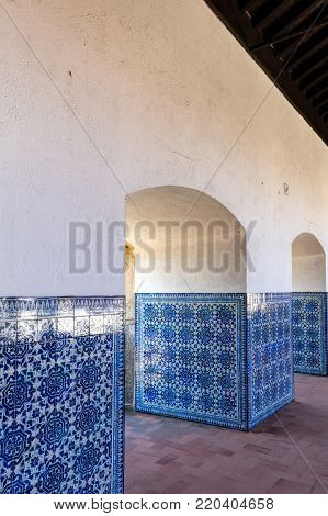 Tomar, Portugal, August 12, 2017: Azulejo tiles decorating the Cloisters of the Convent of Christ in Tomar, Portugal. The convent is a historic and cultural monument and a UNESCO World Heritage site