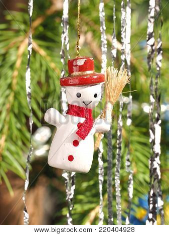 Hand crafted traditional Christmas tree decoration Snowman hanging on  a tree branch, Melbourne 2016