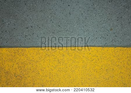 Yellow and grey non-slip safety flooring background in horizontal 3:2 format.