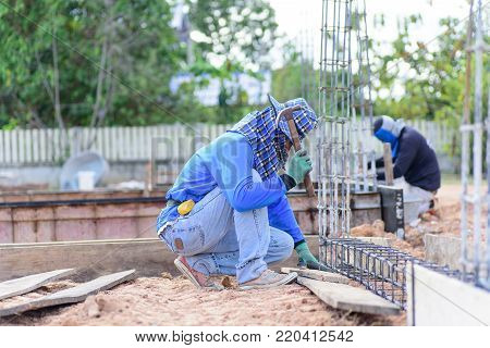 Construction work, the worker making formwork at construction site