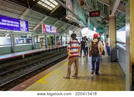 Manila, Philippines - Apr 12, 2017. People waiting at LRT station in Manila, Philippines. Manila is the capital of Philippines and the center of governance, education and finance.