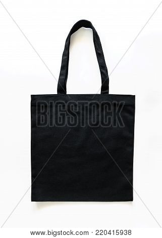 Black canvas tote bag mockup fabric cloth texture for woman's shoulder eco shopping sack mock up template isolated on white background (clipping path)