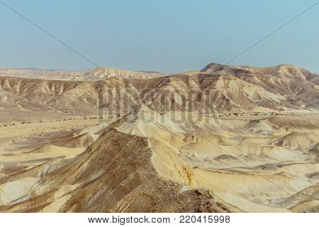Landscape horizon view on dry desert mountains and sky near the dead sea in Israel. Infinity valley panorama of lone sand, rocks, hills and stones. Waterless middle east territory, silence and heat.