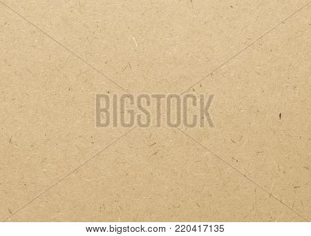 Beige particle pressed wood panel of oriented strand board (OSB) texture background in light brown cream sepia color