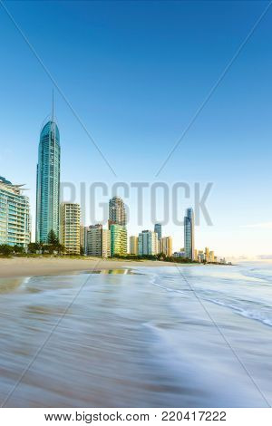 Early morning photograph of buildings of Surfer's Paradise on the shoreline. Surfer's Paradise Beach, Gold Coast, Queensland, Australia.