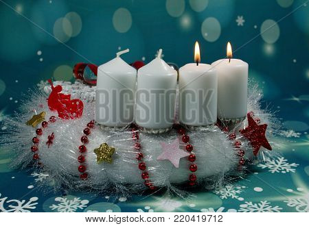 Second Advent Sunday/ candles on an advent wreath/White candles on an advent christmas wreath.