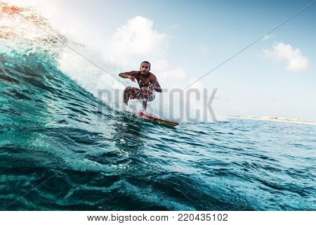 Young surfer rides the wave. Extreme sport and active lifestyle concept