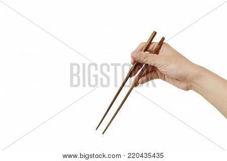hand holding and use wooden chopsticks on white background