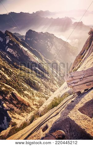 Beginning of the Plank Road trail at Mount Hua, worlds most dangerous hike, color toned picture, China.