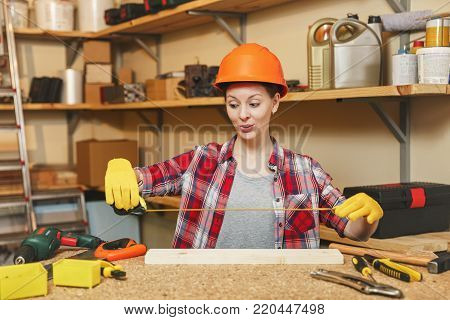 Tired Gaga Caucasian Young Brown-hair Woman In Plaid Shirt And Gray T-shirt Working In Carpentry Wor