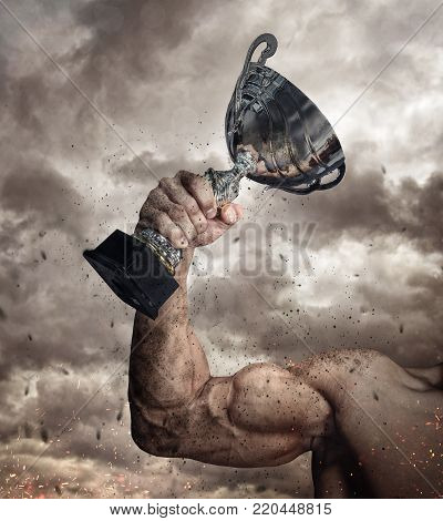 Cropped male arm with winner cup under cloudy sky.