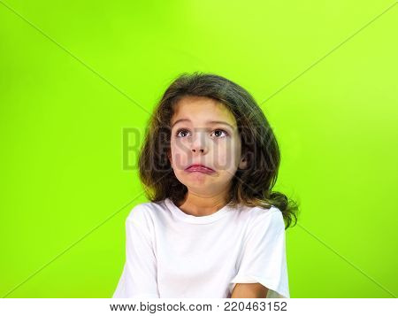 Shocked, Surprised Child Fed Up, Bored Or Showing Despair, Isolated On Green.