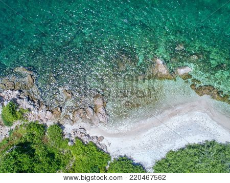 Sea Aerial view, Top view,amazing nature background.The color of the water and beautifully bright.Azure beach with rocky mountains and clear water of Thailand ocean at sunny day.flying drone,sea view