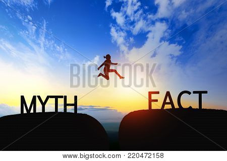 Woman Jump Through The Gap Between Myth To Fact On Sunset.
