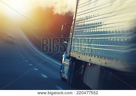 American Semi Truck on the Nebraska Interstate Highway. Ground Shipping Transportation.