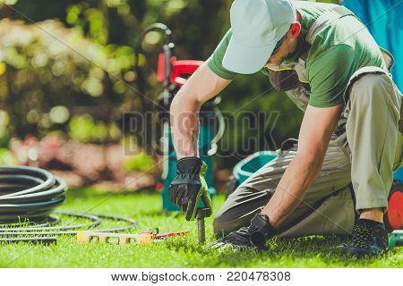Grass Field Sprinklers Installation by Professional Caucasian Garden Systems Installator.