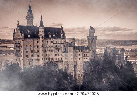 Amazing scene of mystique enchanted Neuschwanstein Castle lost in the fog, the Romanesque Revival palace built for King Ludwig II on a rugged cliff near Fussen, southwest Bavaria, Germany