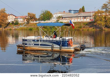 PRAGUE - October 1: Ferry Hol Ka transports passengers from district Karlin to district Holesovice on October 1, 2017 on Vltava river, Czech Republic.