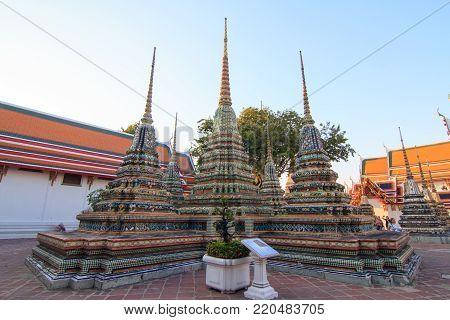 Bangkok , Thailand - 22 December, 2017:  Big pagoda in Wat Arun Ratchawararam Ratchawaramahawihan / Wat Arun Landmark of Thailand in Sunset time