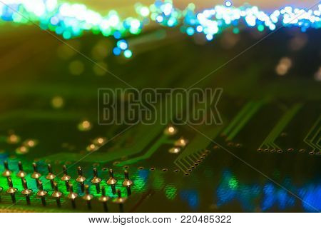 Pins in focus on circuit board, defocused optical fibre background.