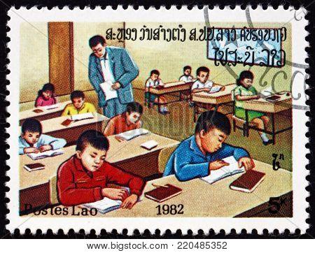LAOS - CIRCA 1982: a stamp printed in Laos shows classroom, education, circa 1982