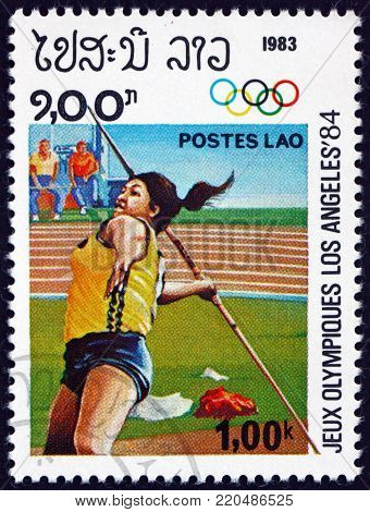 LAOS - CIRCA 1983: a stamp printed in Laos shows women's javelin, 1984 Summer Olympics, Los Angeles, circa 1983