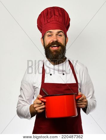 Man With Beard Holds Red Pot On White Background.