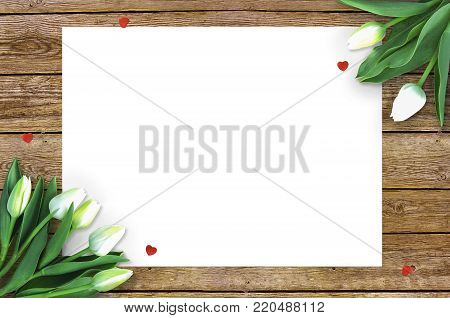 Tulips on wooden background with space for message. Mother's Day background. Flowers on rustic table for March 8, International Womens Day, Birthday , Valentines Day or Mothers day - Closeup.