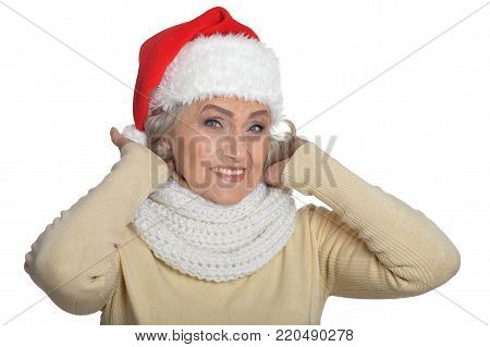 Portrait of senior woman in Santa hat isolated on white bacground