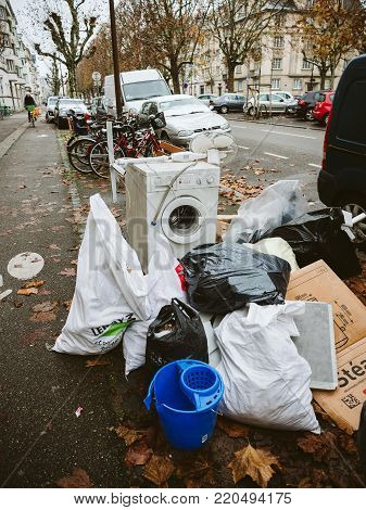 PARIS, FRANCE - DEC 4, 2017: Unauthorized waste after relocation with diverse waste - washing machine, construction waste, repairing junk, relocation waste, obsolete, Leroy merlin