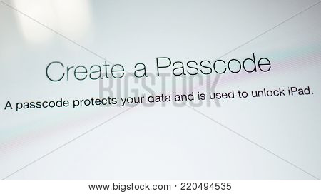 PARIS, FRANCE - SEP 18, 2014: Create a Passcode used for iPAd protection message on the latest iPad tablet retina screen