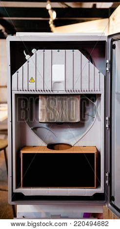 Open door of a central unit of a modern technology Central Vacuum Systems in modern home
