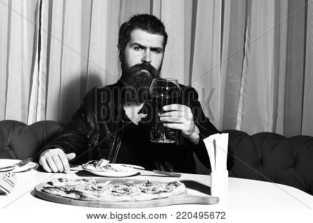 Bearded Man Eating Pizza With Knife And Fork