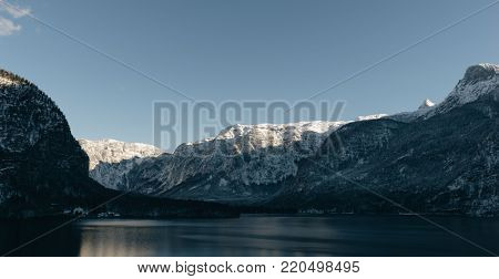 Beautiful sunset landscape. Hallstatt lake with mountains. Amazing travel destinations.