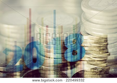 a multiple exposure of some piles of euro coins, some charts and the number 2018, as the new year